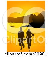 Young Couple Walking On A Beach And Holding Hands A Sailboat In The Distance Silhouetted Against An Orange Sunset
