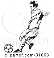 Clipart Illustration Of A Black And White Male Soccer Player Kicking A Ball