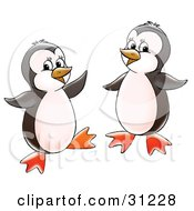 Clipart Illustration Of Two Happy Little Penguins Dancing And Having Fun by Alex Bannykh