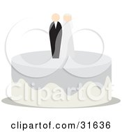Bride And Groom On Top Of A Wedding Cake With Silver And Beige Icing