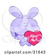 Clipart Illustration Of A Cute Purple Bunny With Blushed Cheeks Holding Up A Red Heart Valentine