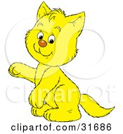 Clipart Illustration Of A Cute Yellow Kitty Cat Sitting Up On Its Hind Legs Raising One Paw
