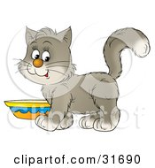 Clipart Illustration Of A Cute Gray And White Kitten Standing By A Saucer Of Milk