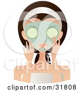 Beautiful Brunette Caucasian Woman With Green Eyes Facing Front Applying A Mask And Holding Cucumbers Over Her Eyes