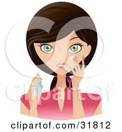 Beautiful Brunette Caucasian Woman With Green Eyes Facing Front And Applying Moisturizing Cream To Her Face