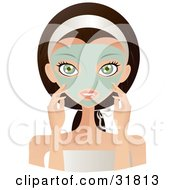 Beautiful Brunette Caucasian Woman With Green Eyes Facing Front And Touching The Green Facial Mask On Her Face