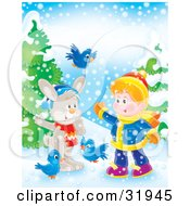 Little Boy Playing With Bluebirds And A Rabbit Outside In The Snow