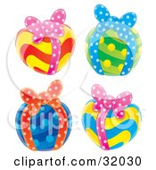 Clipart Illustration Of A Set Of Four Colorful Yellow Red Green Yellow And Blue Gifts With Bows On A White Background