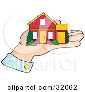 Clipart Illustration Of A Red And Yellow Home Resting In The Palm Of A Mans Hand Symbolizing Mortgage Home Loans Investment And Realty by Maria Bell