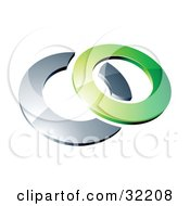 Reflective Green 3d Ring Resting On A Chrome Ring On A White Background