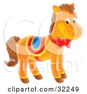 Cute Brown Pony With A Red Ribbon And Bow On Its Neck Wearing A Saddle