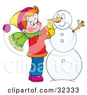 Clipart Illustration Of A Happy Boy Putting A Carrot On His Snowman