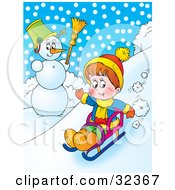 Boy Riding Downhill Past A Snowman On A Sled On A Snowy Winter Day