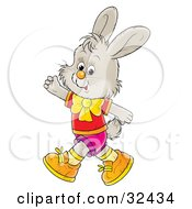 Clipart Illustration Of A Friendly Gray Bunny In Clothes Walking On His Hind Legs And Waving