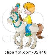 Little Blond Boy Riding A White Horse