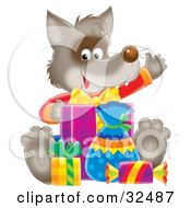 Clipart Illustration Of A Happy Wolf Waving And Sitting With Birthday Gifts by Alex Bannykh