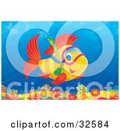 Poster, Art Print Of Cute Red Finned Yellow Fish Snorkeling Over A Coral Reef