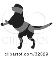 Clipart Illustration Of A Jumping Dog Silhouetted In Black by KJ Pargeter