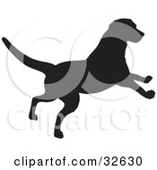 Clipart Illustration Of A Playful Dog Silhouetted In Black