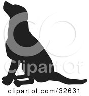 Clipart Illustration Of A Seated Dog Silhouetted In Black