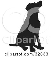 Clipart Illustration Of A Behaved Sitting Dog Silhouetted In Black