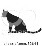 Clipart Illustration Of A Seated Cat Silhouetted In Black Facing Left by KJ Pargeter