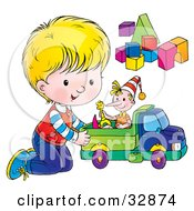 Little Boy On His Knees Playing With A Doll In A Toy Truck By Blocks