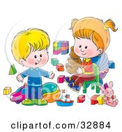 Little Boy And His Sister Playing With Toys In A Nursery Room