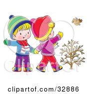 Clipart Illustration Of A Little Boy And Girl Walking Holding Hands And Waving To A Bird On A Winter Day