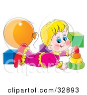 Blond Girl Laying On Her Belly And Playing With Toys In A Nursery