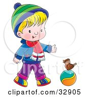 Clipart Illustration Of A Boy In Winter Clothes Talking To A Bird On A Ball by Alex Bannykh
