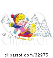 Happy Blond Boy On A Sled Riding Downhill In The Snow