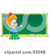 Smart School Girl Standing In Front Of And Pointing To A Blank Chalk Board