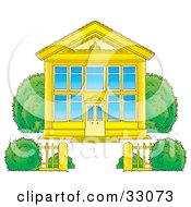 Clipart Illustration Of A Golden School Building With Blue Windows And A Gate