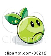 Clipart Illustration Of A Sad Green Organic Smiley Ball With Leaves