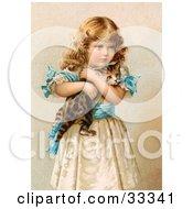 Little Victorian Girl In A Fluffy Dress Hugging Her Scared Kitten