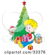Clipart Illustration Of A Kitty Wearing A Santa Hat Peeking Around A Christmas Tree And Watching A Blond Boy Open Presents