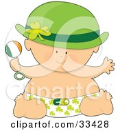 Baby In A Hat And Shamrock Diaper Holding A Rattle And Having Fun On St Patricks Day