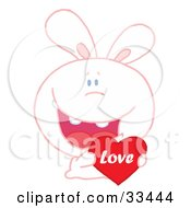 Loving White Bunny Rabbit Grinning And Holding A Red Love Heart Valentine