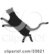 Clipart Illustration Of A Black Silhouetted Feline Leaping In Profile
