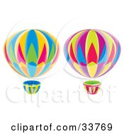 Two Colorful Hot Air Balloons Flying On A White Background