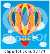 Clipart Illustration Of A Colorful Diamond Patterned Hot Air Balloon In A Blue Cloudy Sky by Alex Bannykh