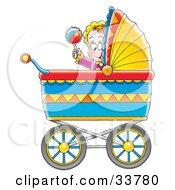 Happy Baby Playing With A Rattle In A Colorful Baby Carriage
