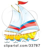 Sailing Boat With White Red And Blue Sails And A Red Flag
