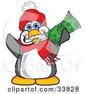 Clipart Illustration Of A Penguin Mascot Cartoon Character Grinning And Holding Up A Green Dollar Bill by Toons4Biz