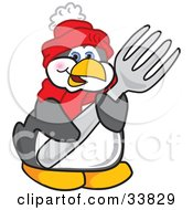 Clipart Illustration Of A Penguin Mascot Cartoon Character Holding A Big Fork by Toons4Biz