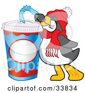 Clipart Illustration Of A Thirsty Penguin Mascot Cartoon Character Drinking Soda Pop Through A Bendy Straw by Toons4Biz