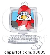 Clipart Illustration Of A Penguin Mascot Cartoon Character Waving From Inside A Computer Screen by Toons4Biz