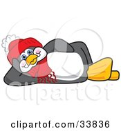 Clipart Illustration Of A Relaxed Penguin Mascot Cartoon Character Laying On His Side by Toons4Biz