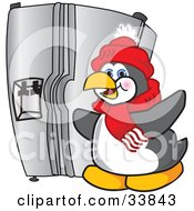 Clipart Illustration Of A Penguin Mascot Cartoon Character Standing By A Stainless Steel Refrigerator